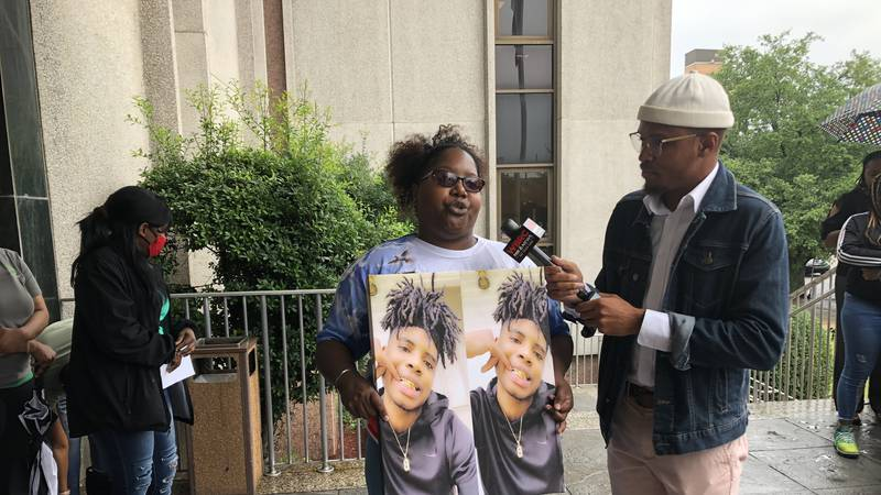 Sharon Carter holds a picture of her son, Xzavier Eatmon outside the Tuscaloosa County...