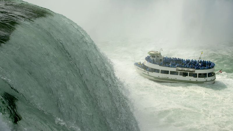 The Maid of the Mist navigates the turbulent waters of the lower Niagara river at the base of...