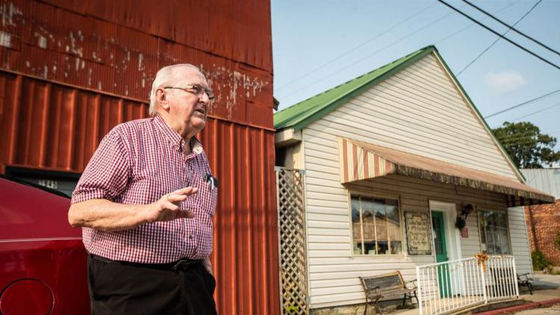 Mayor John Landers discusses a new senior center on Tuesday while standing beside the current...
