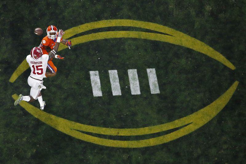 FILE - Alabama's Ronnie Harrison (15) breaks up a pass intended for Clemson's Artavis Scott...