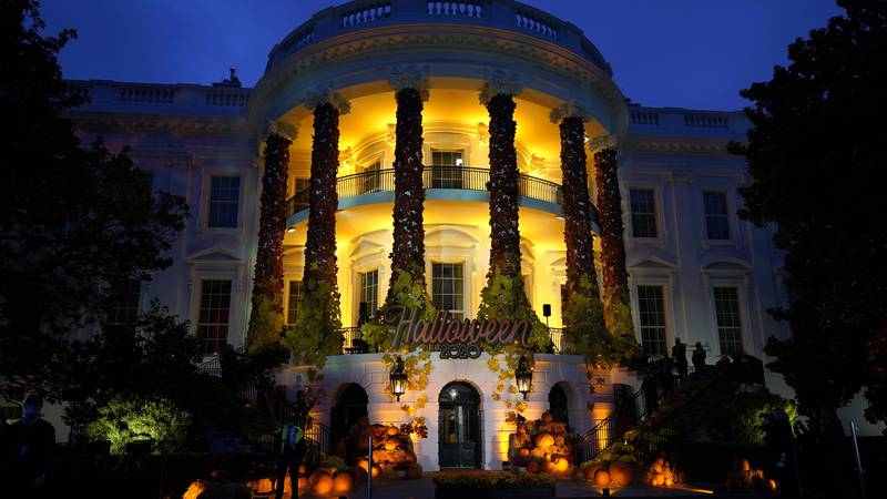 FILE - In this Oct. 25, 2021 file photo, the South Lawn of the White House is lit during a...