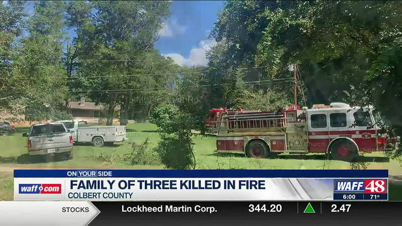 Family of three killed in fire