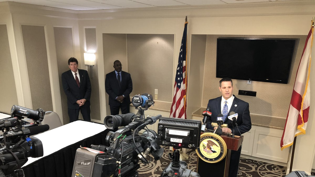 US Attorney Northern District Jay Town at the podium, behind and left-right, Southern District...