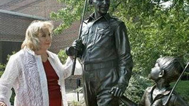 Betty Lou Lynn stands beside a statue of Andy Griffith and Opie. (Photo source: Gerry Broome /...