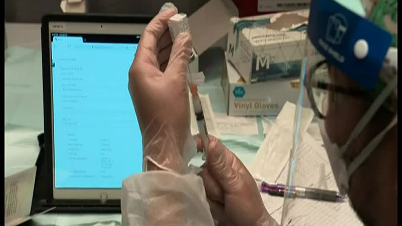 Officials say the Covid-19 vaccine made a major dent in the pandemic but the rate of Americans...