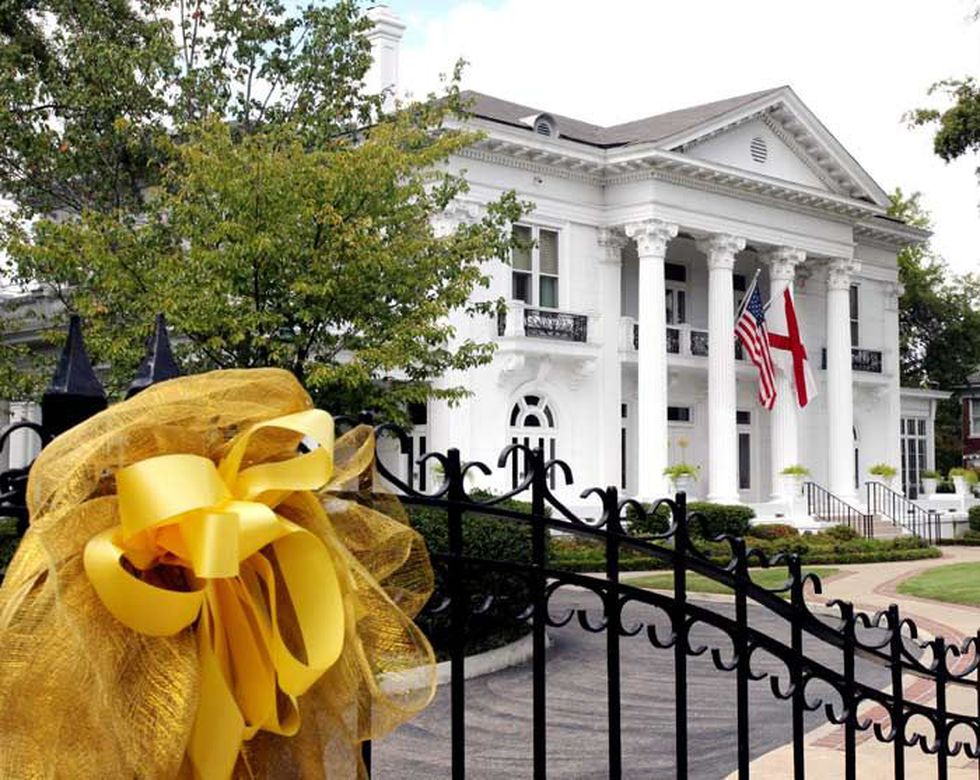 Gold ribbons hang on the gate at the Alabama Governor's Mansion on S. Perry Street in...