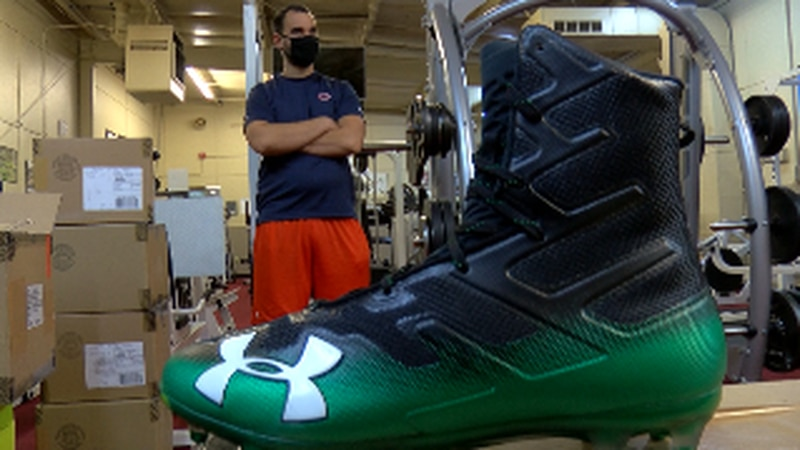 Huntsville City Schools football coaches receive football cleats, gloves from The Boys and...
