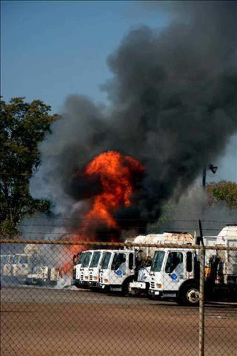 A Sunday afternoon fire started at one garbage truck, but soon spread. (Source: Jeff S.)