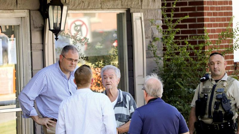 Attorney Ron Smith (left) and murder suspect Roger Stevens (right) arrive to examine the scene...