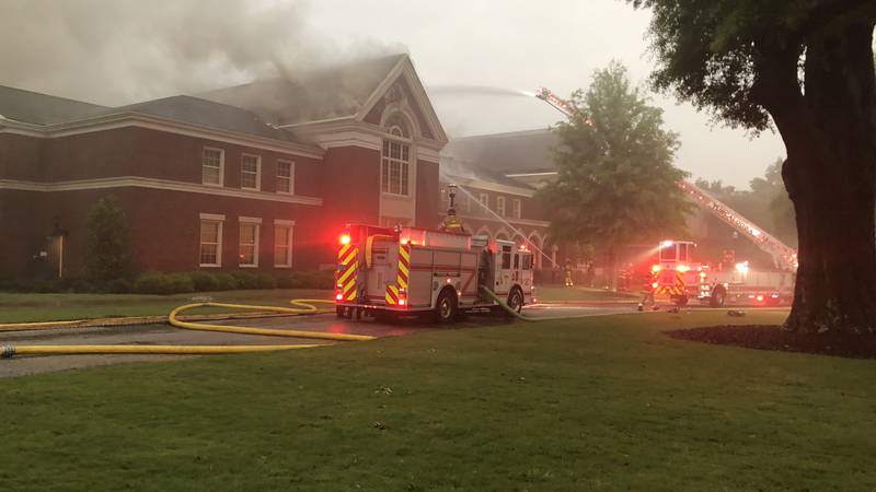 Tuscaloosa fire fighters on the scene of a fire at the Moody Music Building at the University...