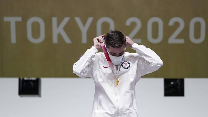 William Shaner of the United States puts his gold medal on after the men's 10-meter air rifle...