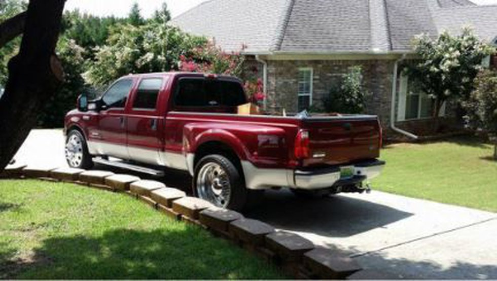 The stolen truck is a red 2005 F-350. Attached with it was a black 24-foot trailer. (Source:...