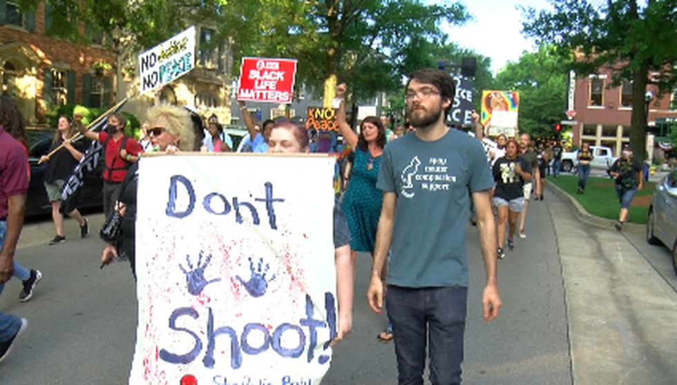 One year after the march ending with rubber bullets and tear gas, dozens of people march for...