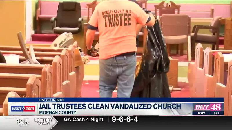Jail trustees clean vandalized church
