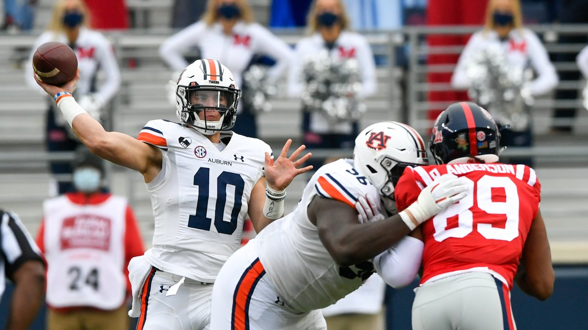 Oct 3, 2020; Oxford, MS, USA; Bo Nix (10) throws the ball to Seth Williams (18) for a gain of...