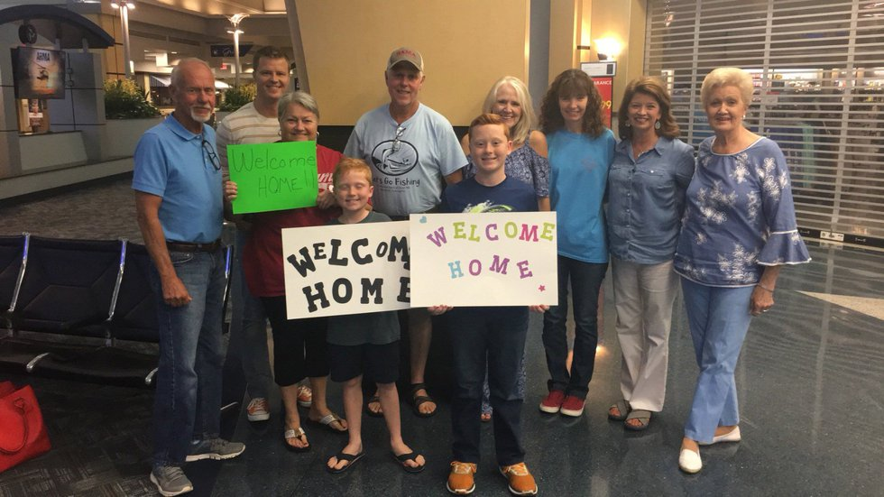 Families wait to greet the Petersville Church of Christ missionaries returning from Haiti. They...