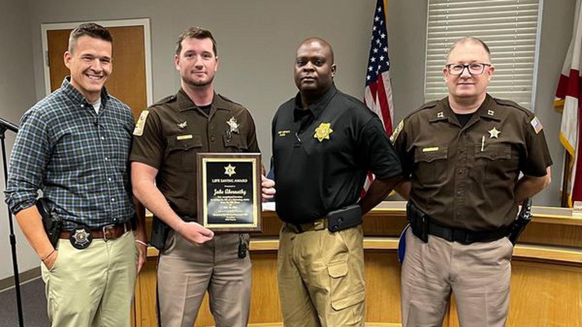 Two deputies received a Life Saving Award after saving drowning victim.