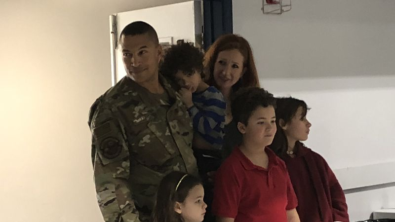 Sgt. Jonathan Lewis with his wife and their four children