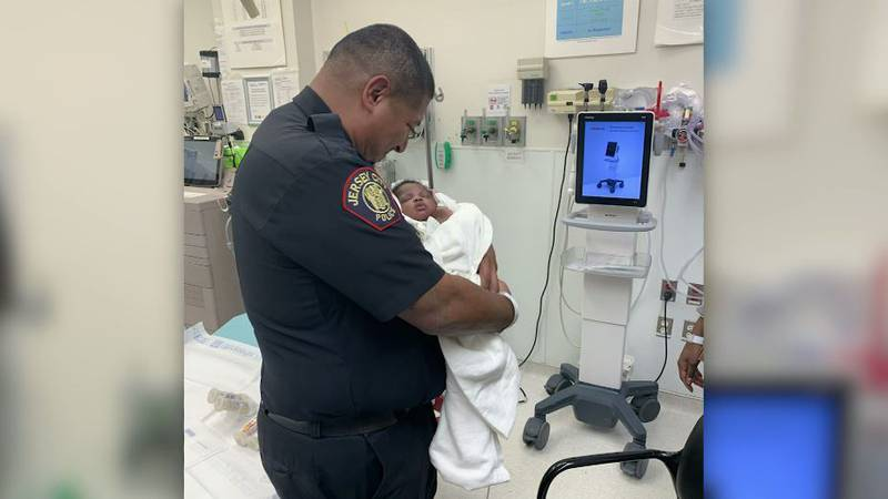 Officer Eduardo Matute safely caught a 1-month-old baby who was thrown from the second floor...