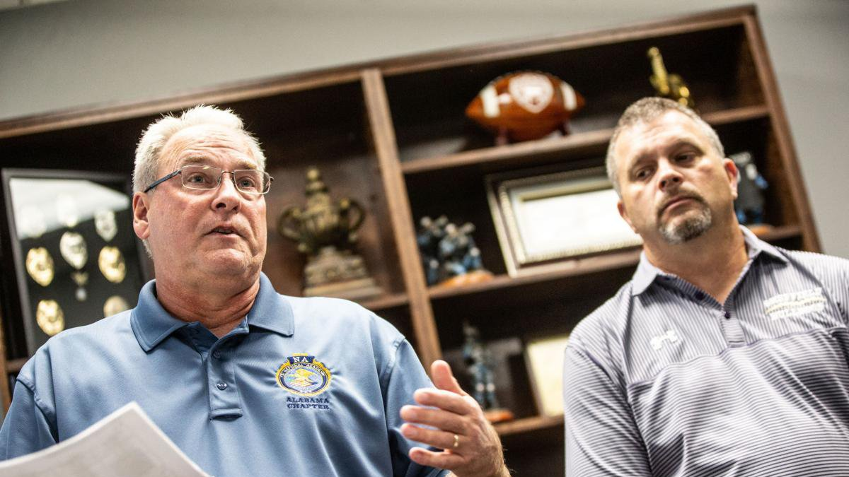 Muscle Shoals Police Chief Clint Reck, left, and Sheffield Police Chief Ricky Terry give a...