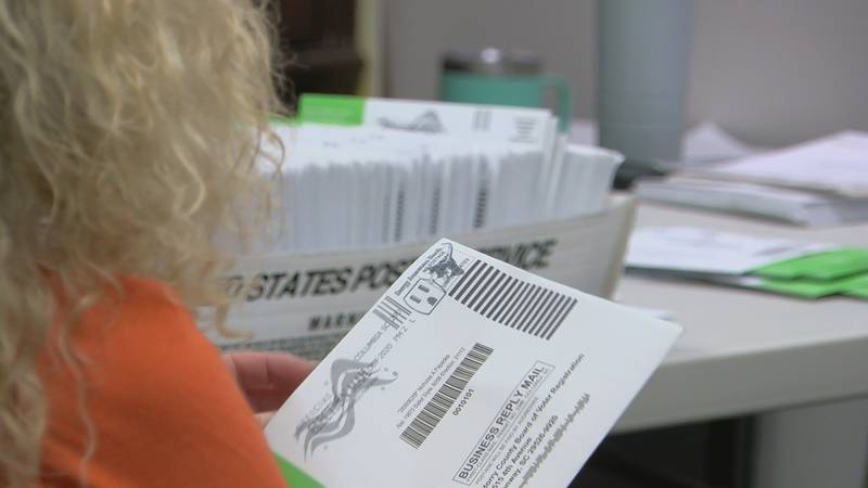 Sunday was the first time election officials were allowed to open mail in absentee ballots...