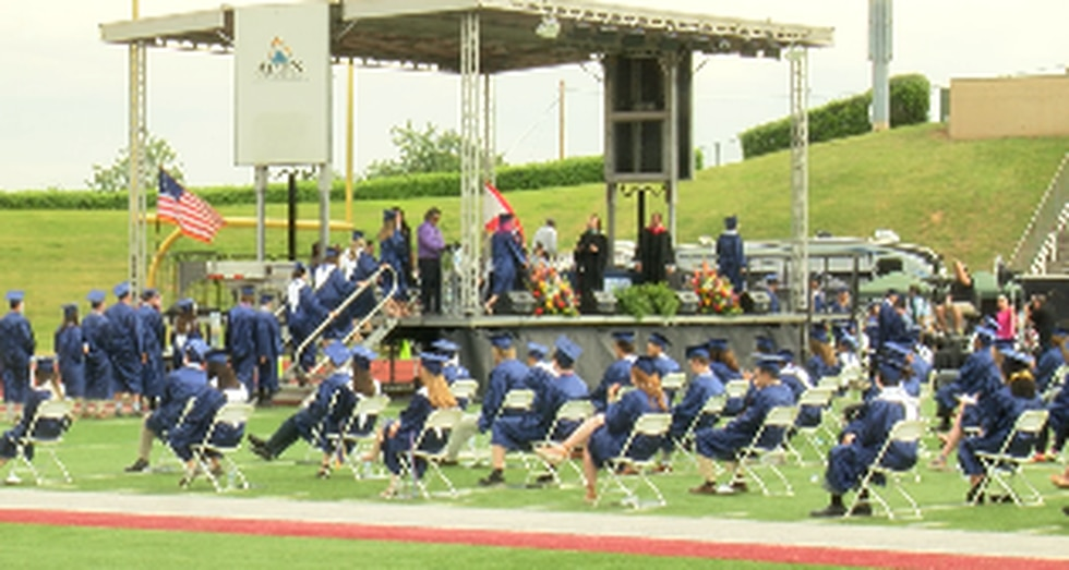The district held two ceremonies at Alabama A&M's stadium Monday.