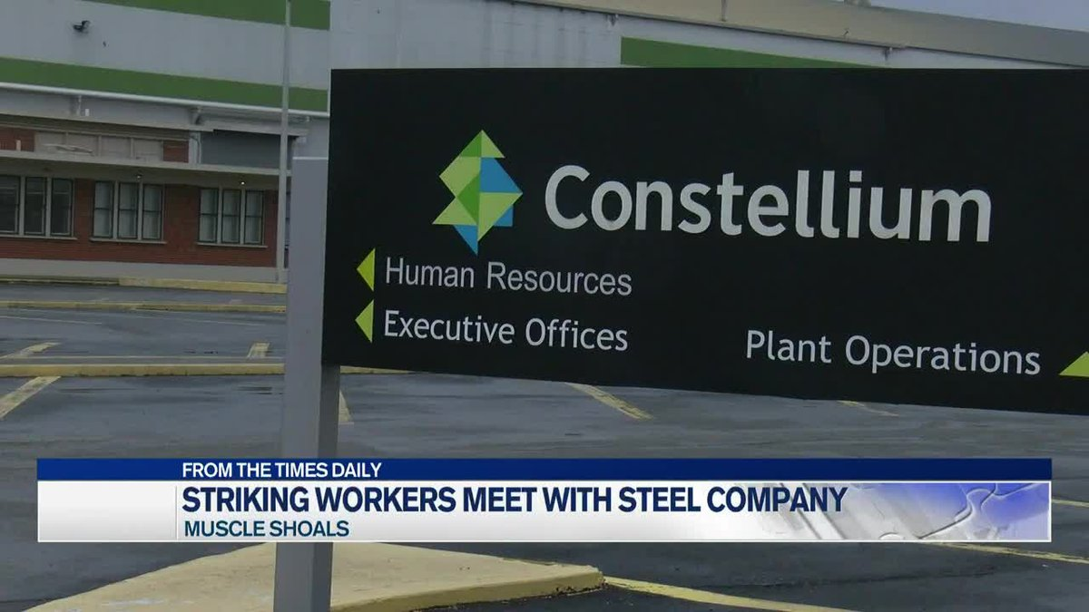Striking workers meet with steel company