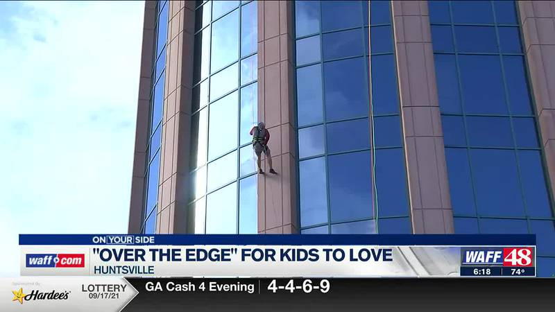 Fundraisers rappelled down Regions Bank in Huntsville to support Kids to Love.