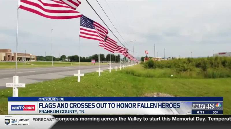 Flags and crosses are on display to honor fallen heroes