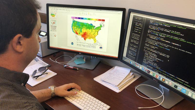 Dr. David Keeling looks at data on his computer at the University of Alabama