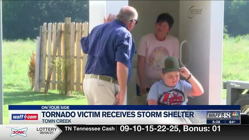 Tornado victim receives new storm shelter
