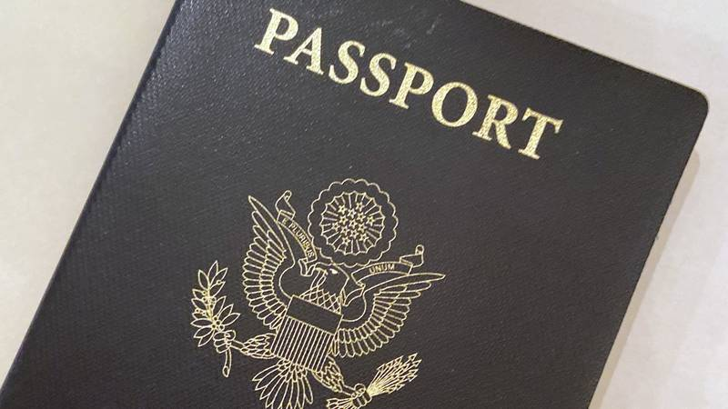 FILE - This May 25, 2021 file photo shows a U.S. passport cover in Washington.