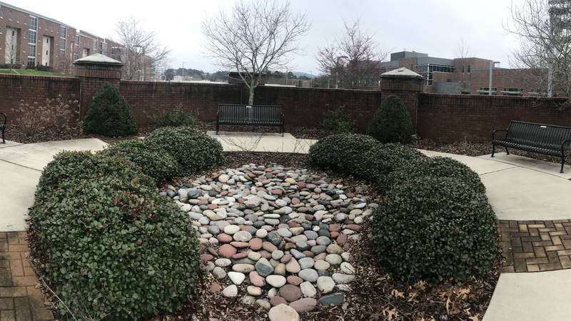A living garden along UAH's greenway serves as a reminder of the murders perpetuated by Amy...