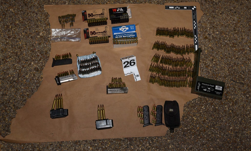 Photos of weapons and ammo provided in court documents in case against Lonnie Coffman.