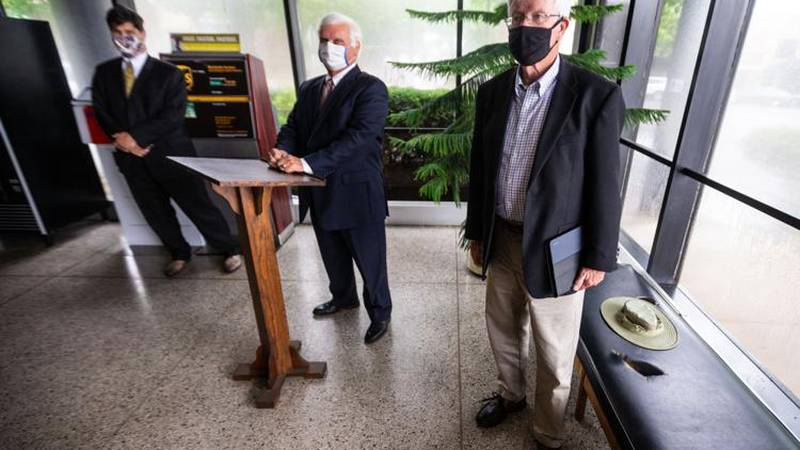 From left, attorney Bill Love, plaintiff John Sutherland and Barry Morris gather for a press...