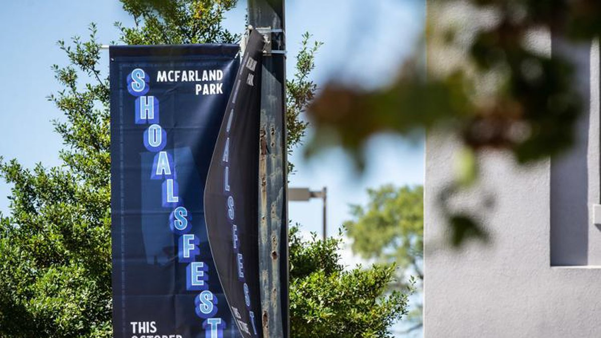 Banners promoting the upcoming ShoalsFest music festival have been attached to traffic light...